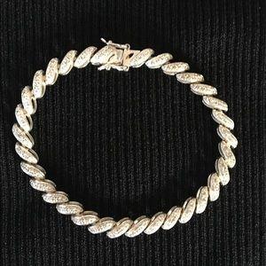 Diamond chip silver bracelet.